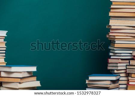 stacks of educational books university library background #1532978327