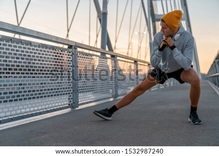 Young male morning workout rutine on bridge outdoors. Healthy Lifestyle. Cardiovascular workouts - Stock Image #1532987240