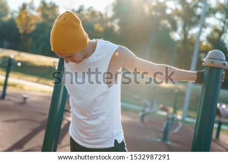 Young male morning workout rutine on bridge outdoors. Healthy Lifestyle. Cardiovascular workouts - Stock Image #1532987291
