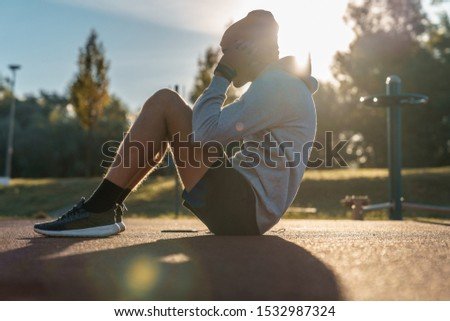 Young male doing morning workout rutine outdoors. Healthy Lifestyle. Cardiovascular workouts - Stock Image #1532987324