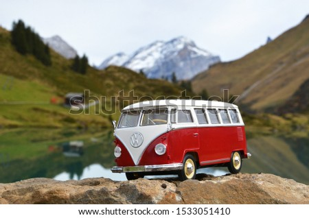 Gosau, Austria – October 12th 2019: Miniature VW Bulli 1962 in the mountains. The cult car of the Hippie generation and it remained the status vehicle of all travelers #1533051410