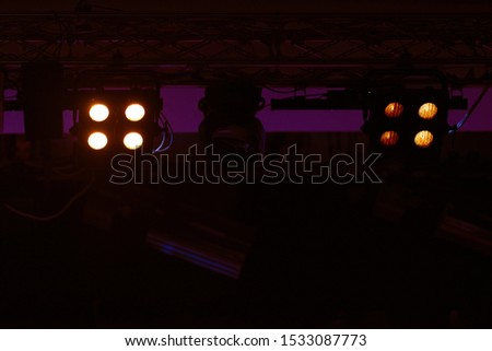 An empty stage of the theater, lit by spotlights and smoke before the performance #1533087773