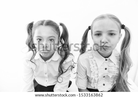 Unhappy cuties. Unhappy little schoolchildren isolated on white. Adorable small girls with unhappy emotions looking in camera. Unhappy because of school starts. #1533163862