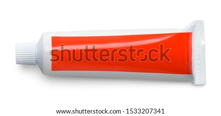 Small Red Toothpaste Tube Isolated on White. Royalty-Free Stock Photo #1533207341