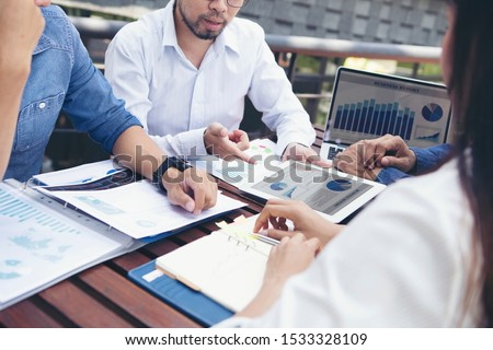 Group businessman meetings to brainstorm, analyze and plan for marketing. #1533328109