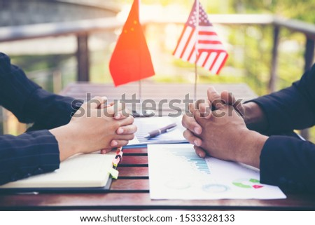 Two investors between China and the US America is negotiating for business. #1533328133