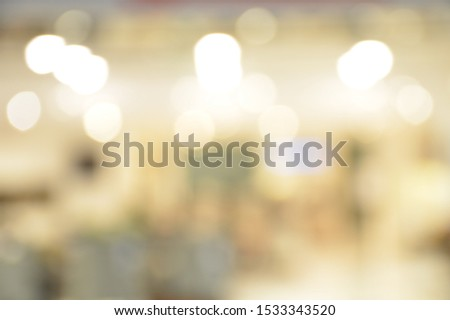 Abstract blur image of luxury shopping mall with bokeh lights,use for backdrop or web design,interior design.