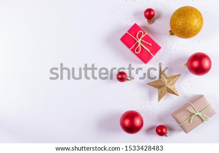 Christmas composition. Christmas gifts, red and golden decorations on white background. Flat lay, top view, copy space for text. #1533428483