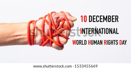 Red rope on lift hand with 10 december international HUMAN RIGHTS DAY text on white background, Human rights day concept #1533455669