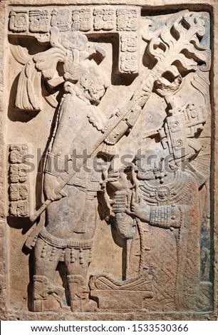 Facade of an ancient rock tablet with Mayan hieroglyphic.   #1533530366