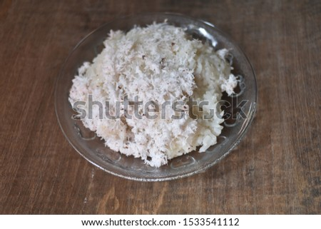 Ketan kelapa parut is Indonesian traditional food, made from boiled sticky rice with grated coconut #1533541112