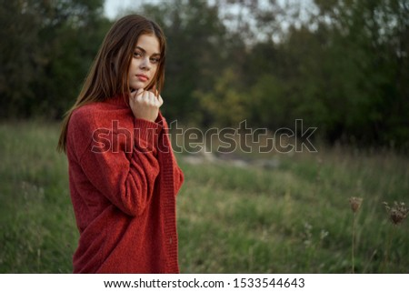 young woman looking at the camera beautiful in a forest grove #1533544643