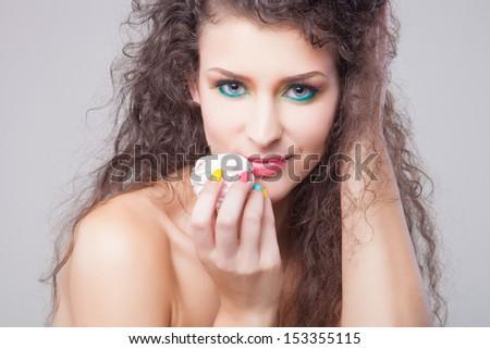 Portrait of pretty girl eating marshmallows #153355115