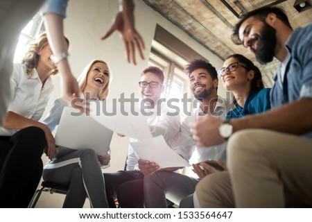 Group of business professionals having a meeting. Diverse group of designers smiling at the office. #1533564647