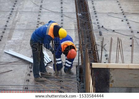 Belarus, Minsk,2015. Team workers construction site building architecture #1533584444