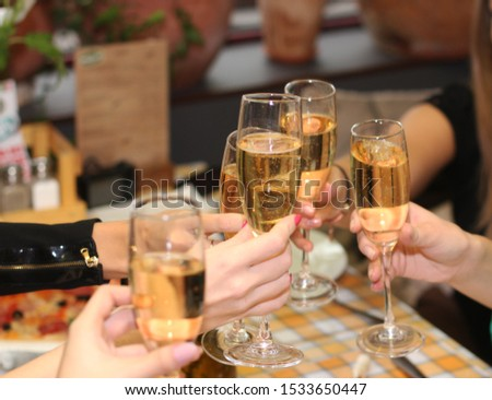 People hold champagne glasses in their hands. #1533650447