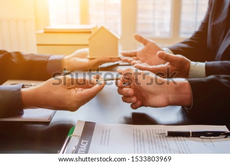 The customer is entering into a contract to hire the real estate in the sales office and file a loan to buy the estate and pay monthly installments to the finance company that made the loan submission #1533803969