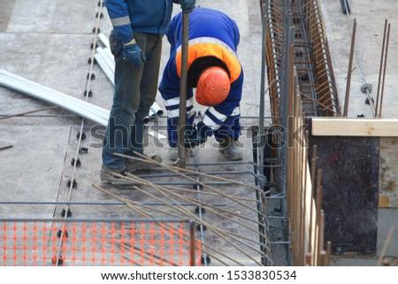 Belarus, Minsk,2015. Team workers construction site building architecture #1533830534