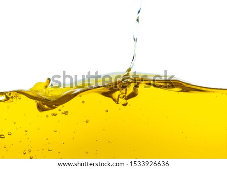 Beautiful wave of high viscosity of base oil and air bubble inside the oil isolated on white background. Used in automotive and industrial application. Used as wallpaper, industrial concept #1533926636