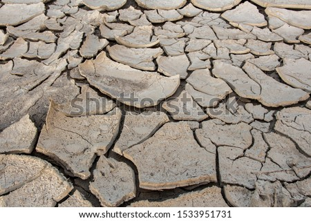 cracks in the ground, deep crack, cracked desert landscape, effects of heat and drought. effects of global warming, texture background #1533951731