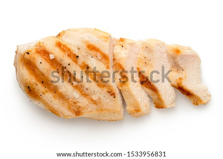Partially sliced grilled chicken breast with grill marks, ground black pepper and salt isolated on white. Top view. #1533956831