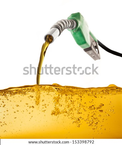 Nozzle pumping gasoline in a tank Royalty-Free Stock Photo #153398792