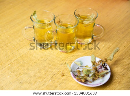 Herbal linden tea, anti-inflammatory tea in glass glasses. Dry linden blossom on a saucer. #1534001639