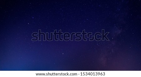 Panorama blue night sky milky way and star on dark background.Universe filled with stars, nebula and galaxy with noise and grain.Photo by long exposure and select white balance.selection focus.amazing #1534013963
