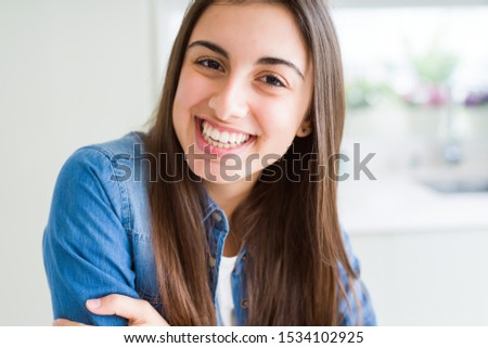 Beautiful young brunette woman smiling cheerful looking at the camera with a big smile on face showing teeth #1534102925