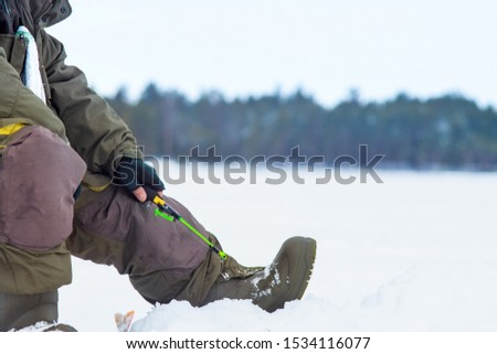 winter sport, winter fishing outside on the ice. Fishing on the winter lake #1534116077