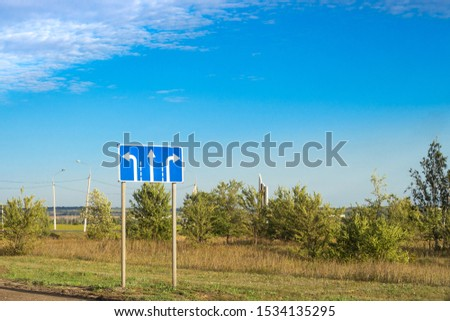 traffic sign on a blue background with the direction of movement left, right and right #1534135295