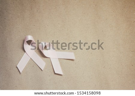 Pink ribbon. Symbol of breast cancer awareness. Health care conception. Preventive measures. October checking time.  #1534158098