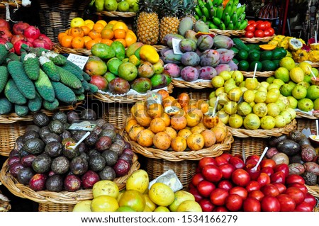 Fruit market with various colorful fresh fruits and vegetables #1534166279