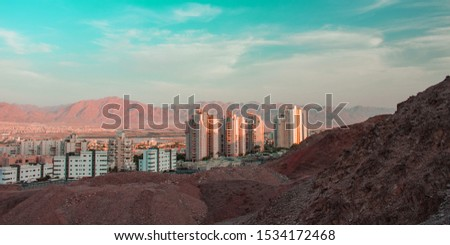 Gulf of Aqaba city living building from Middle East desert hills view point with blue sky and Jordanian mountain background  #1534172468