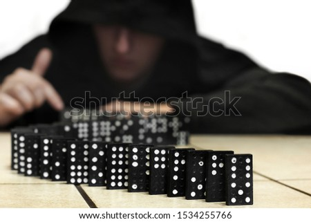 Guy and dominoes. Domino game #1534255766