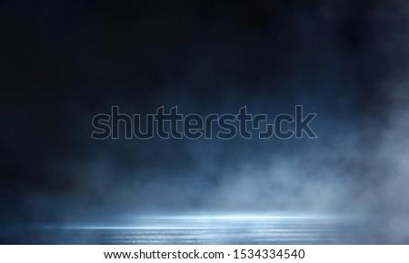 Dark street, wet asphalt, reflections of rays in the water. Abstract dark blue background, smoke, smog. Empty dark scene, neon light, spotlights. Concrete floor #1534334540