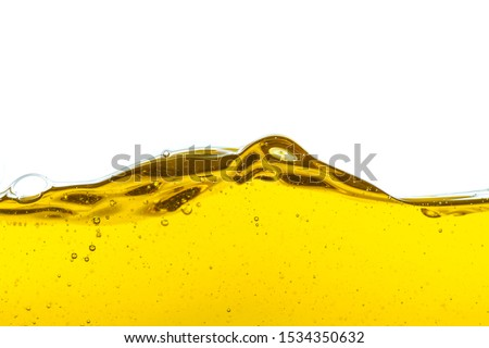 Beautiful wave of high viscosity of base oil and air bubble inside the oil isolated on white background. Used in automotive and industrial application. Used as wallpaper, industrial concept #1534350632