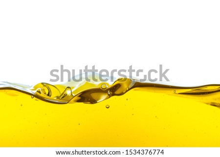 Beautiful wave of high viscosity of base oil and air bubble inside the oil isolated on white background. Used in automotive and industrial application. Used as wallpaper, industrial concept #1534376774