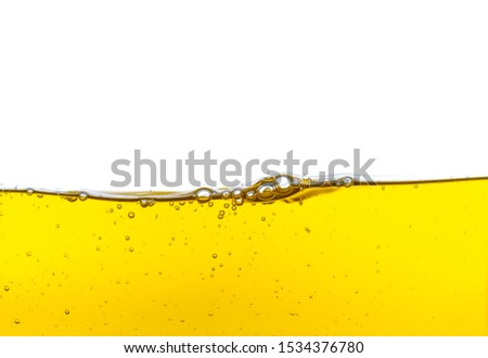 Beautiful wave of high viscosity of base oil and air bubble inside the oil isolated on white background. Used in automotive and industrial application. Used as wallpaper, industrial concept #1534376780
