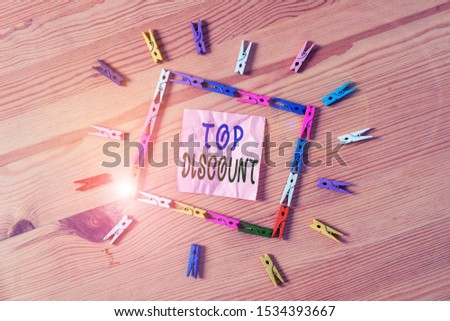 Text sign showing Top Discount. Conceptual photo Best Price Guaranteed Hot Items Crazy Sale Promotions Colored clothespin papers empty reminder wooden floor background office.