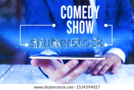 Word writing text Comedy Show. Business concept for Funny program Humorous Amusing medium of Entertainment Male human wear formal work suit presenting presentation using smart device. #1534394027