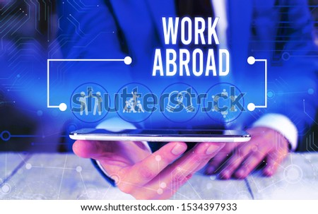Word writing text Work Abroad. Business concept for Immersed in a foreign work environment Job Overseas Non Local Male human wear formal work suit presenting presentation using smart device. #1534397933