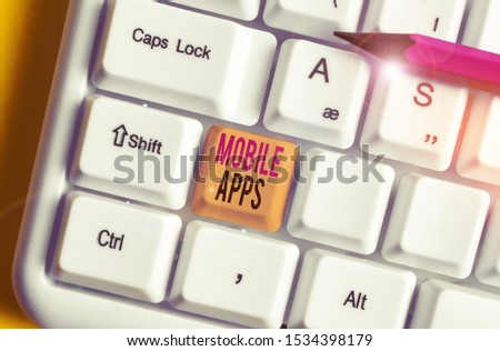 Conceptual hand writing showing Mobile Apps. Business photo text small programs are made to work on phones like app store or app store White pc keyboard with note paper above the white background. #1534398179