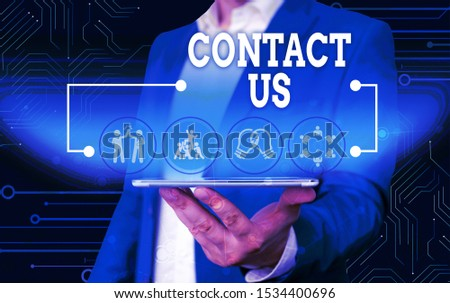 Conceptual hand writing showing Contact Us. Business photo text Group of demonstrating that rendering costumer service through telecom Male wear formal work suit presenting presentation smart device. #1534400696