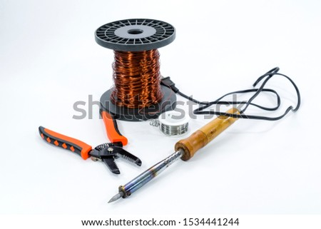 Soldering iron solder wire copper wire on roll and cable cutters on white background is craftsman tool electronic #1534441244