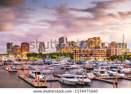 West Palm Beach, Florida, USA downtown skyline on the Intracoastal Waterway at dusk. #1534475660