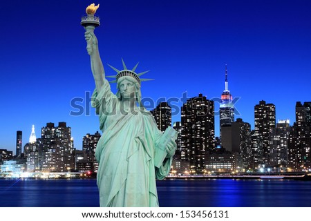 Midtown Manhattan Skyline and The Statue of Liberty at Night, New York City #153456131