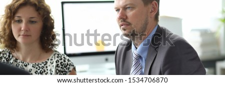Portrait of businesspeople sitting in conference room and discussing important business project with colleagues. Biz meeting and negotiations concept. Blurred background #1534706870