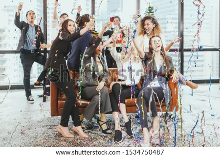 Staff at the office party to celebrate the festival atmosphere of Christmas or New Year. For a party to celebrate the success of the company.Business and celebration concept. #1534750487