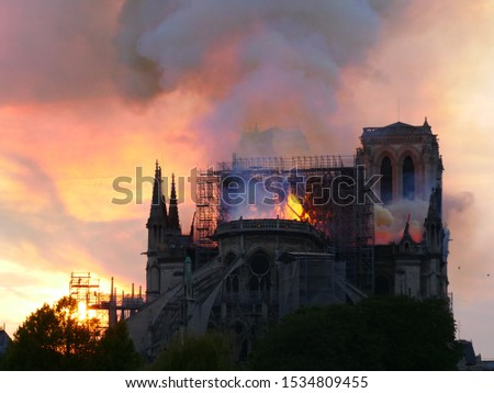 Paris, France - 04.15.2019 : Notre Dame still burning after the huge roof fire. #1534809455